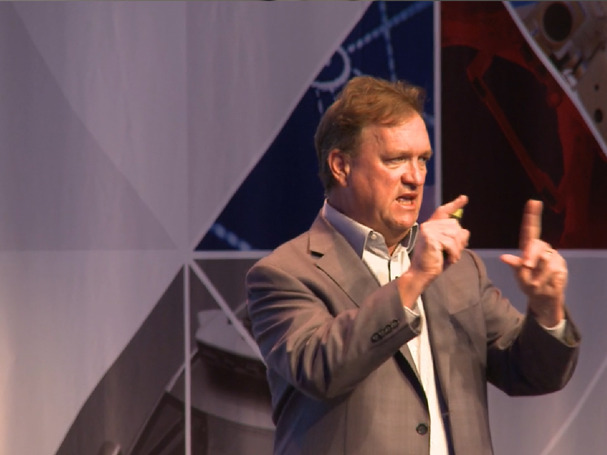 picture of Jim Carol speaking at event