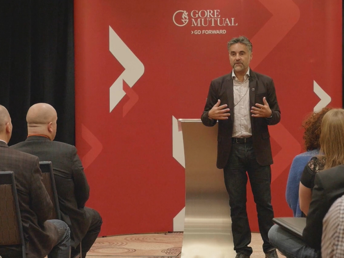 Picture of Bruce Croxon presenting at GoreMutual meeting