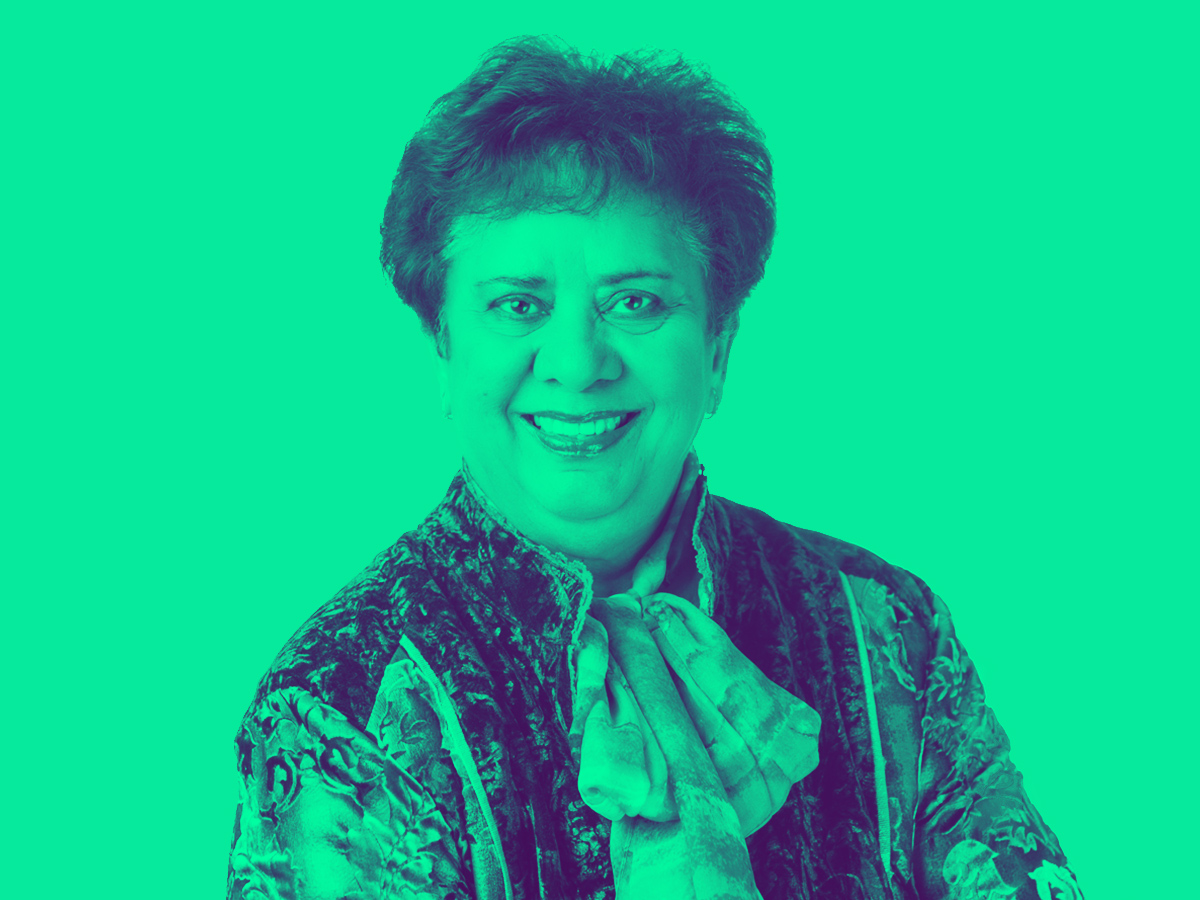 picture of Gloria Murphy smiling with a green tint