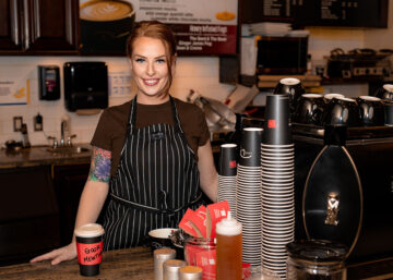 Picture of Chelsea Fitzpatrick smiling at cafe